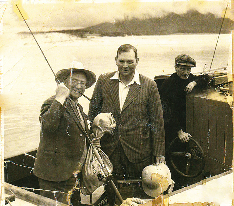 "The Scottish Music-Hall Singer/Comedian Sir Harry Lauder (L) with Clive Firth (C) and Jock Dinse (R) abord the ""EDITH"" at Bermagui, 1938 Photo Mrs Sylvia Dinse"